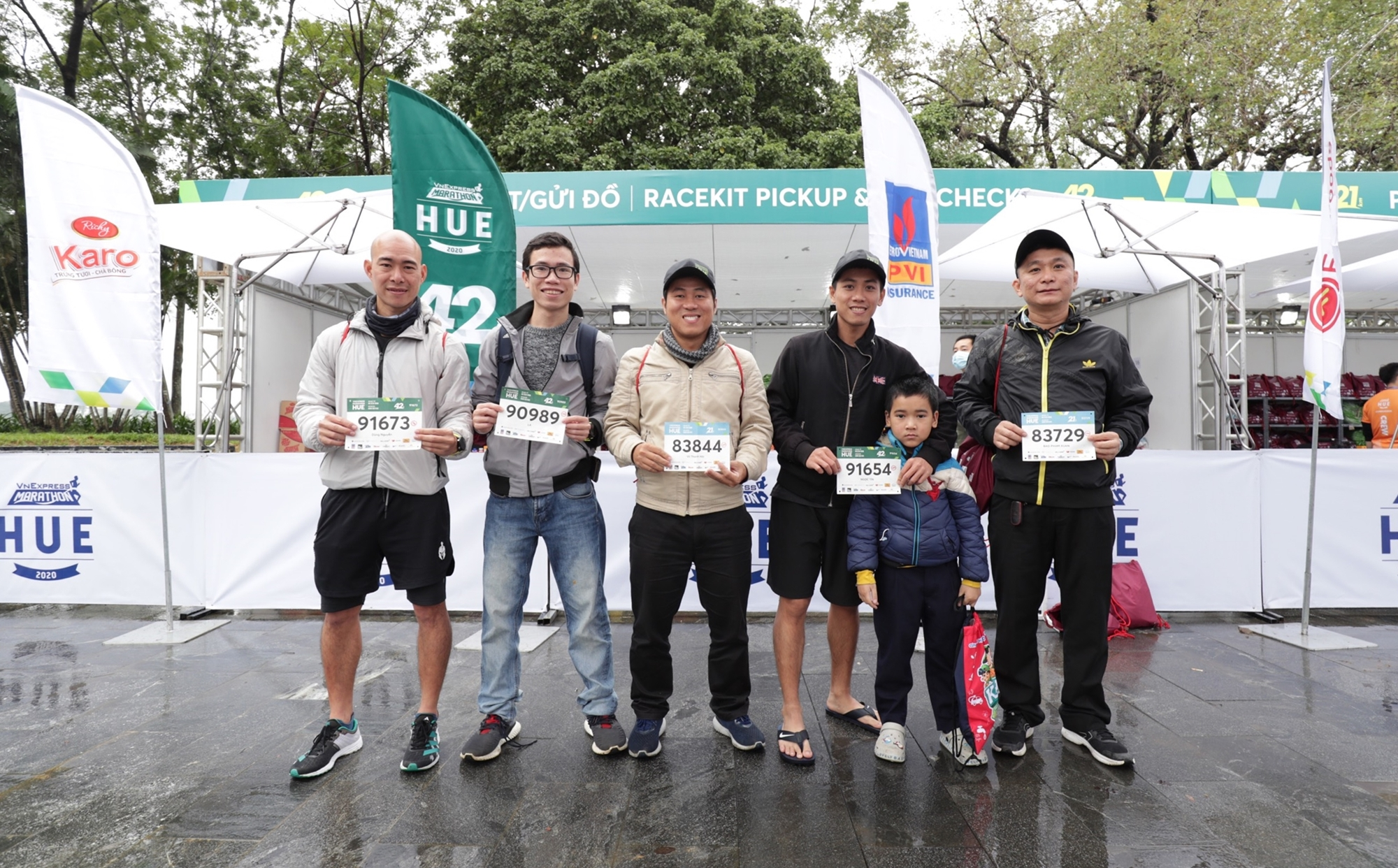 Runners line up in the rain for VnExpress Hue Marathon Bibs
