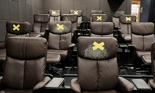 A cinema in Saigon used the X mark to keep distance among moviegoers. Photo by VnExpress/Quynh Tran.