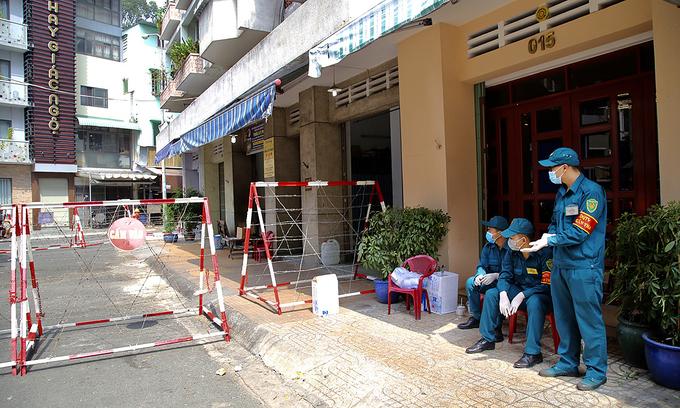 Saigon apartment blocks enter lockdown after resident tests positive for novel coronavirus