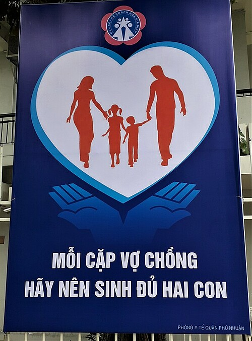 A propaganda poster authored by the Health Department of Phu Nhuan District, HCMC, calls for couples to have two children. Photo by Samantha Coomber.
