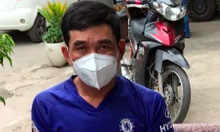 Phan Thanh Hung, 39, is arrested in An Giang Province as a suspected mastermind of a human smuggling ring from Cambodia in to Vietnam, December 31, 2020. Photo courtesy of the police.