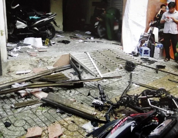 Dust and debris scatter at a police station in HCMC after two bomb blasts in June 2018. Photo courtesy of the police.