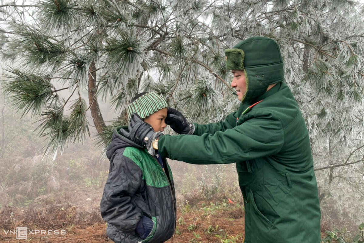 During a routine patrol, a border guard carefully instructs locals in ways to keep themselves, their cattle, poultry, and plants warm and healthy.
