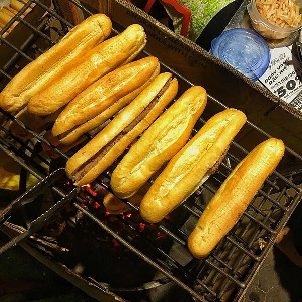 Pate stuffed bread on smoldering coals. Photo courtesy of Hoa Co Dai.