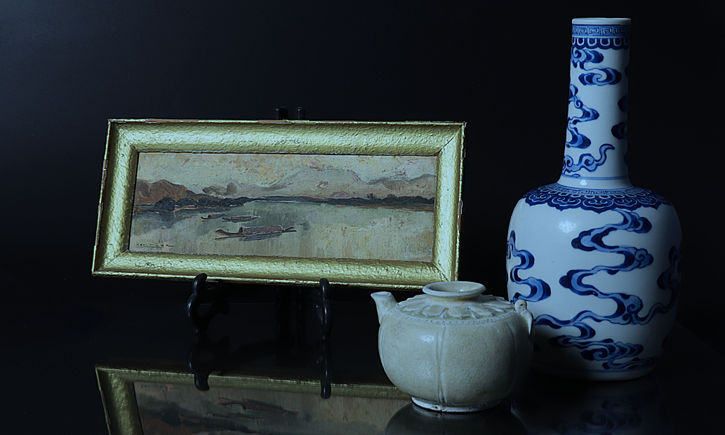 A painting and artifacts that will be featured at the auction. Photo courtesy of PI Auction House.
