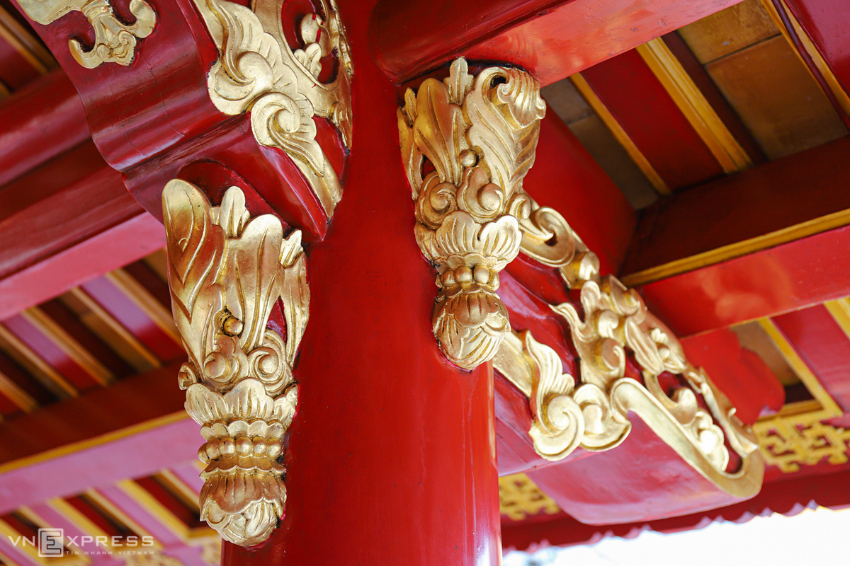 Carefully carved patterns on wooden beams and pillars.