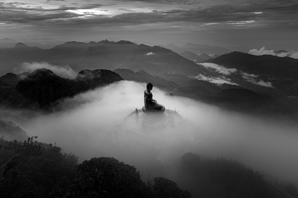 A bronze statue of Buddha sits on the top of Mount Fansipan at a heigh of 3,143 meters above sea level, Lao Cai Province. Photo by Le Viet Khanh.
