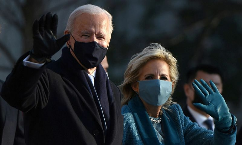 U.S. President Joe Biden and first lady Jill Biden wave at the crowd as they head to the White House after the 2021 inauguration, in Washington, U.S., January 20, 2021. Photo by Reuters/Callaghan OHare.