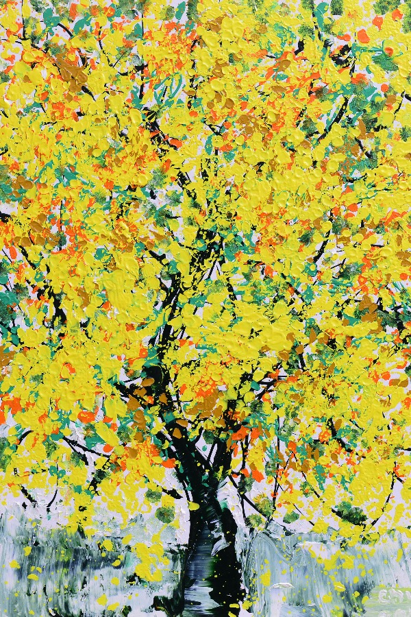 The painting of a yellow mai tree that Chu made for his mother graces their living room now. Photo courtesy of Xeo Chu.