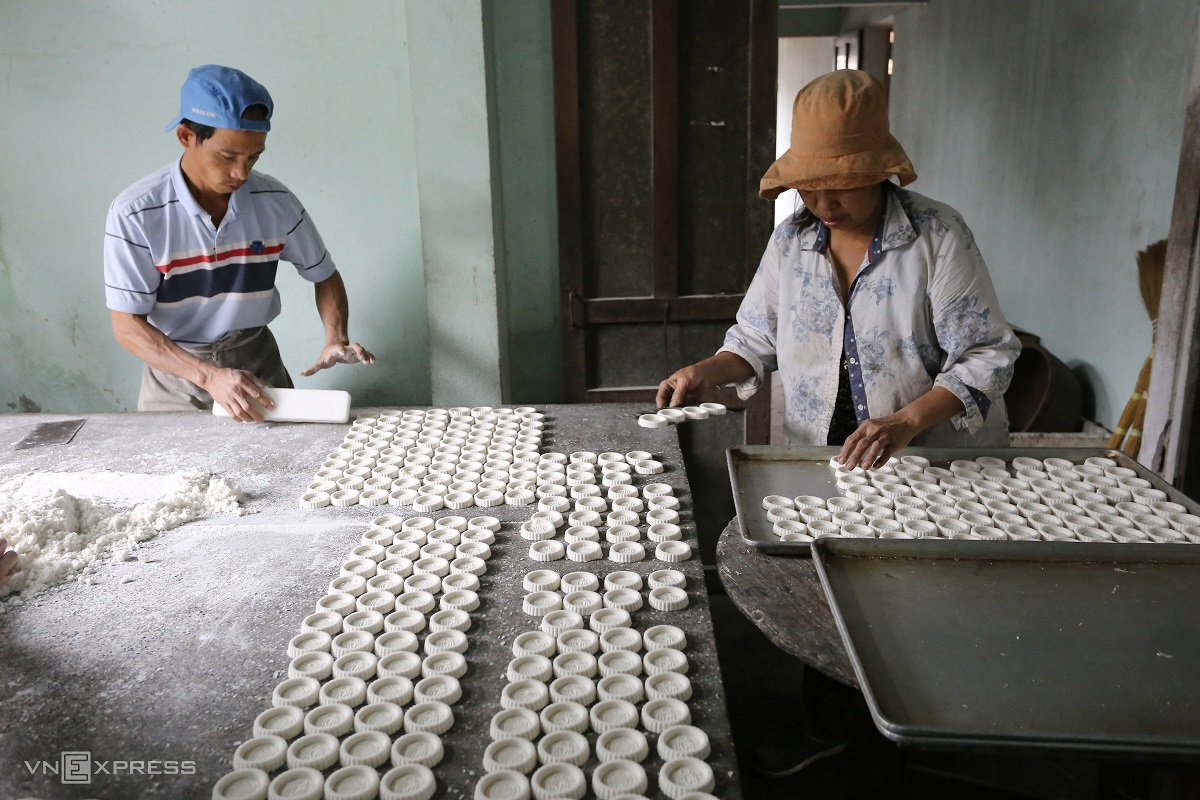 Though the process is not complicated, workers must handle the cakes with care, Hung, a cake maker (left), said.