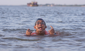 Vietnamese amateur athlete plans to keep swimming against the tide