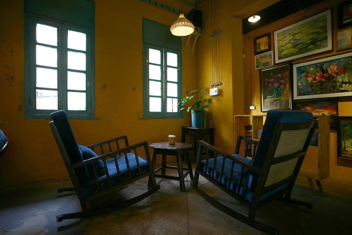 The cafe has preserved the buildings original front windows, which provide a calming light to a second floor nook.