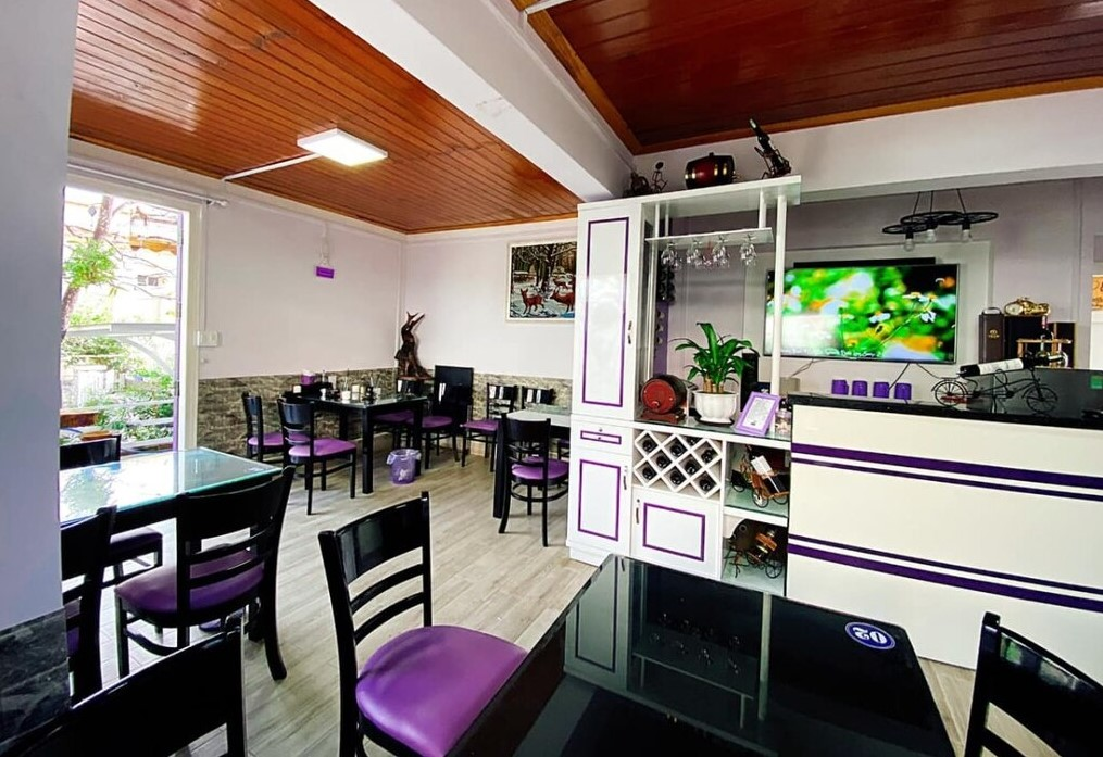 The purple theme runs throughout the interior and exterior of the restaurant.