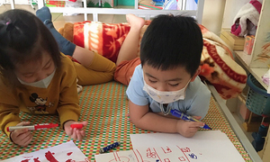 Quarantined kindergarten kids miss home