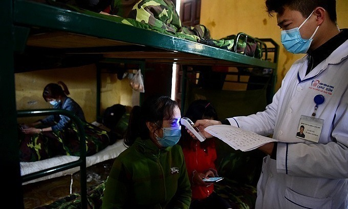 Vietnam cuts Covid-19 quarantine period back to 14 days