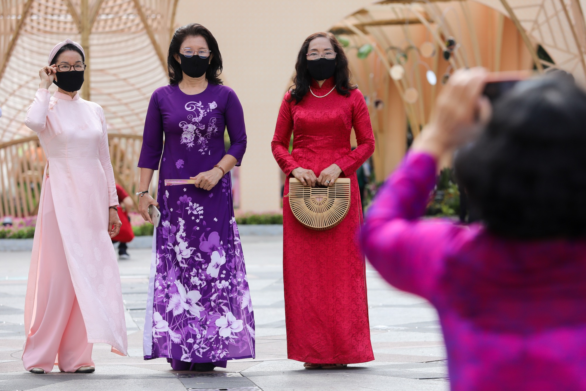 Many women visited the flower street dressed in the traditional ao dai and had photographs taken while wearing masks.