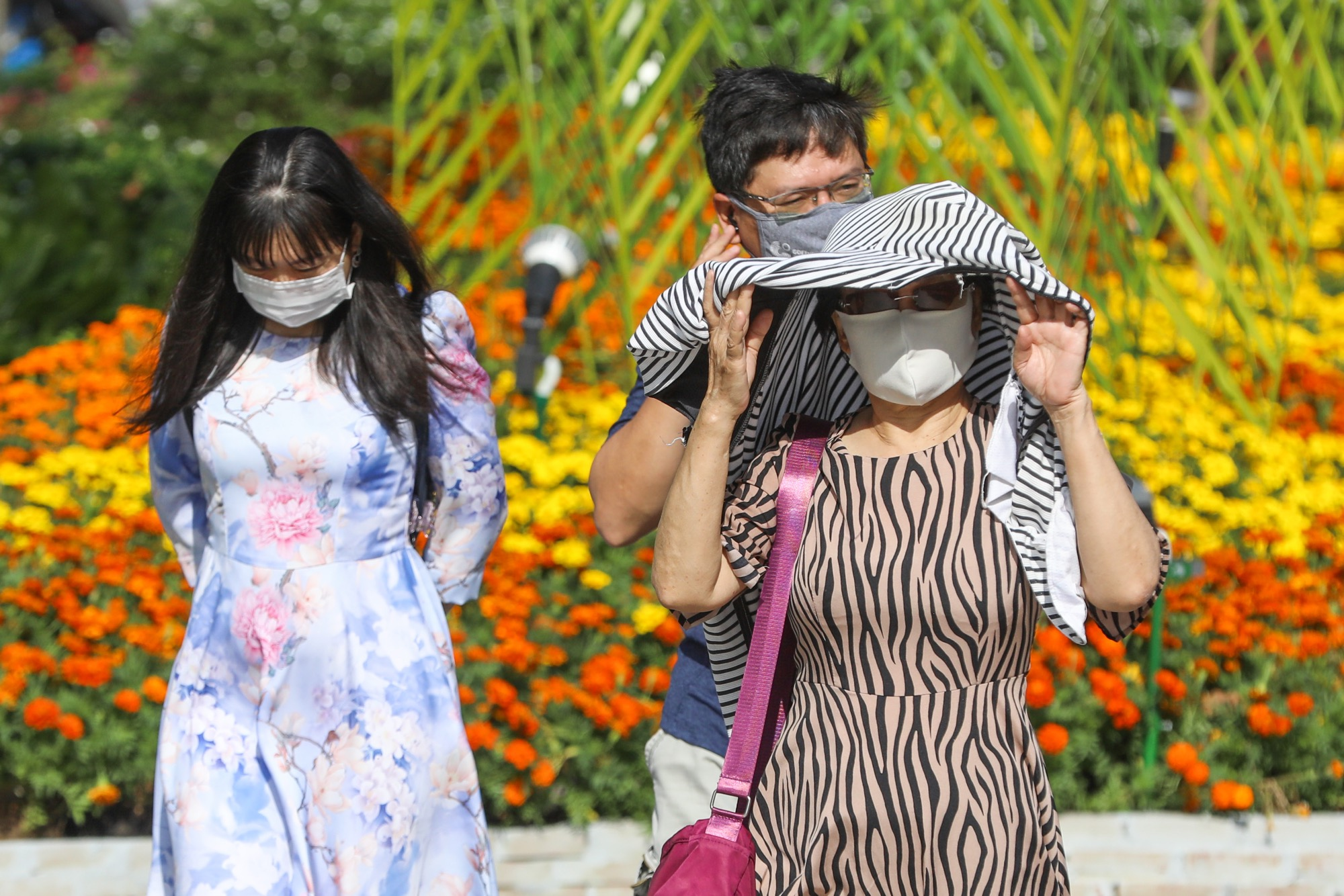 As it got hotter towards noon, many visitors said the masks made them uncomfortable.