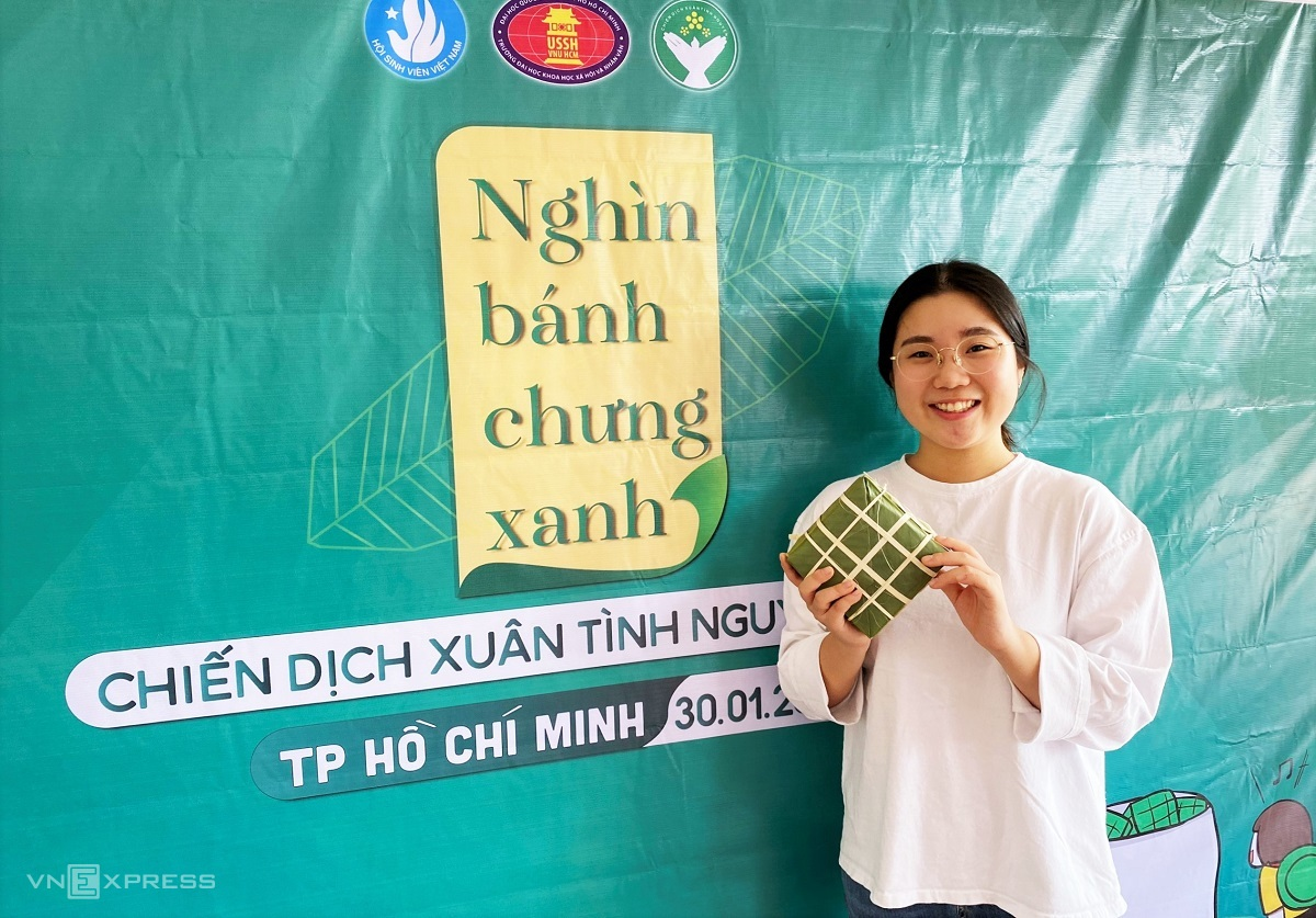 South Korean student Ju Hee holds up a wraped chung cake at school. Instead of flying back to Korea this Tet, she will settle for calling home to check in on her parents.