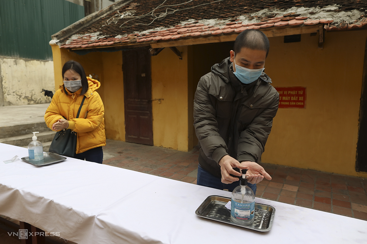 Outside the pagoda, a long table was set up with hand sanitizers, the bottles placed two meters apart.