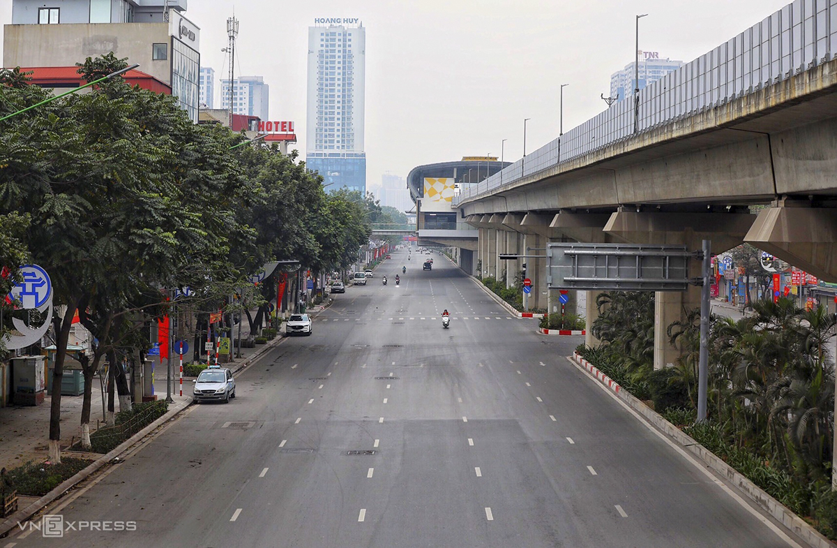 The Nguyen Trai Street that runs towards downtown Hanoi is a ghost of its usual crowded self.
