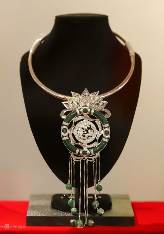 A necklace with a stylized pendant resembling a lotus, the national flower of Vietnam, that won the first prize at the 2017 Hue Traditional Handicraft Festival.