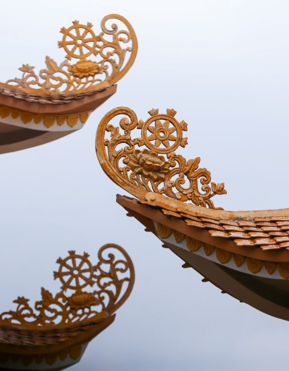 Its curved roofs are adorned with stylized lotus flowers and Falun wheels.