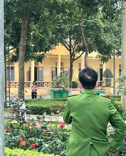 Police officer Nguyen Van Hai looks at his wife from a distance. Photo courtesy of Hai.