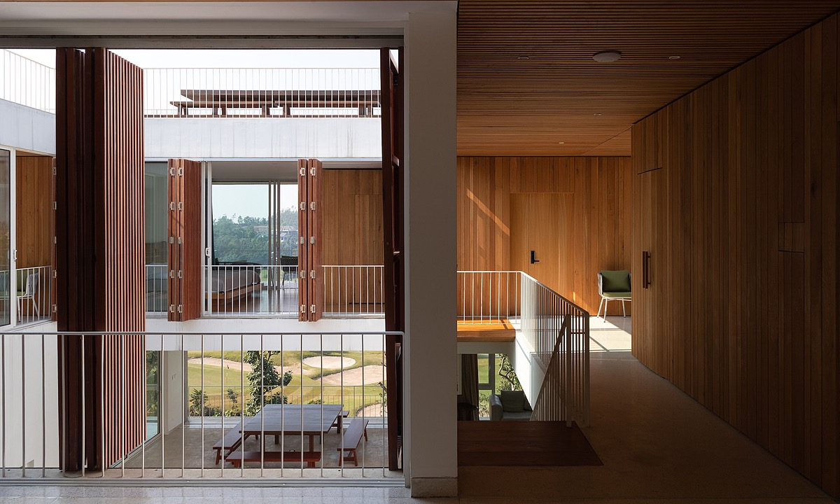 Several windows allow wind and light into the villa.