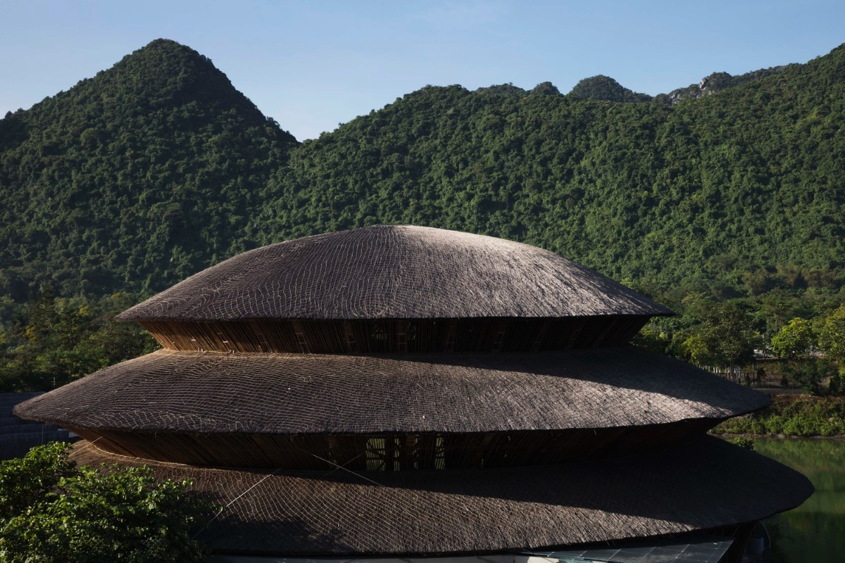 The bamboo dome harmonizes with surrounding mountains and water.