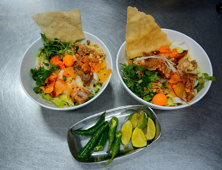 The Quang noodles have a distinct flavor. A bowl of this delicious dish contains noodles, broth, pork and fresh vegetables topped with scallion, cilantro and peanuts. The broth has the sweetness of finely crushed shrimp and the elements on this dish complement each other so well.