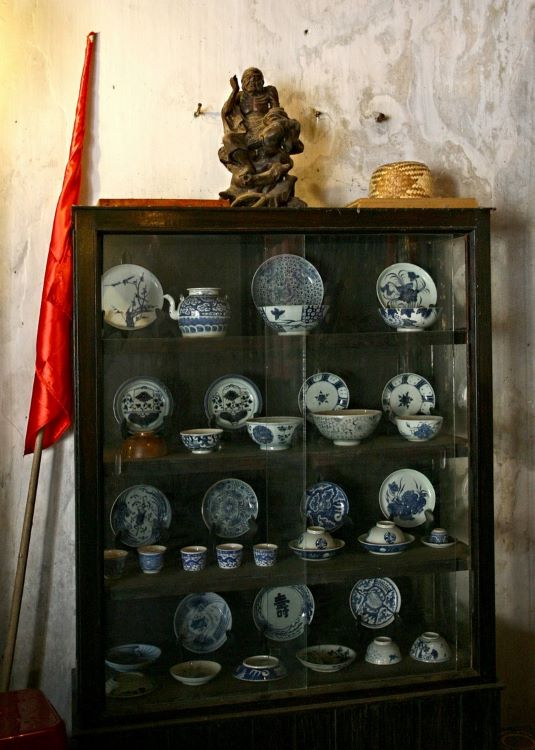 Centuries-old chinaware in a glass cabinet.