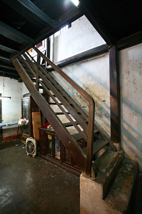 The innermost room is a bedroom with a staircase leading to the second floor.