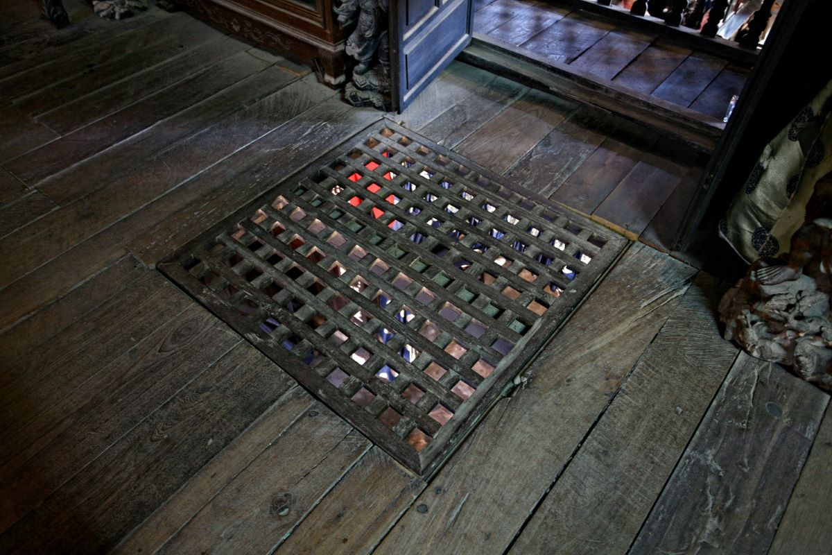 The square window on the floor tells the story of how its inhabitants cope with seasonal flooding. Commodities are shifted to the upper floor through this window.