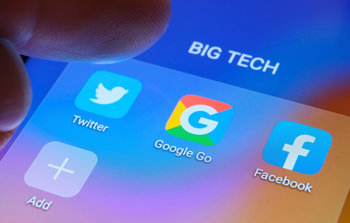 Logos of Twitter, Google and Facebook are shown on a screen. Illustration photo by Shutterstock.