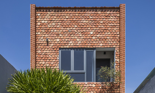 Fish-scale tiles, interior courtyard add Moroccan touch to Tay Ninh home