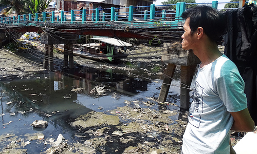 Polluted Saigon canal drives citizens to the brink after two decades