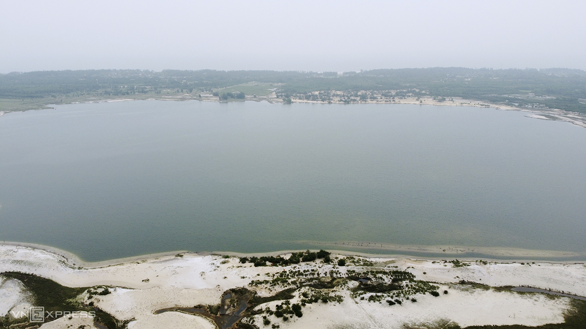 An area that was one an open pit iron mine has now become a lake that is tens of meters deep.