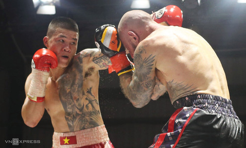 Vietnamese boxing champ beats retired Scottish opponent in tough bout