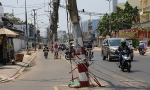 80 power poles left in the middle of Saigon street