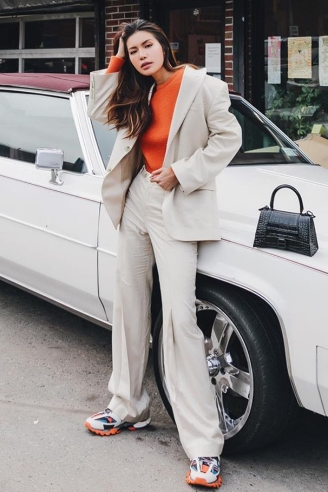 Model Minh Tu in a relaxed suit with a pair of big sneakers, representative of the dad shoes craze of the last few years. Photo courtesy of Minh Tu.