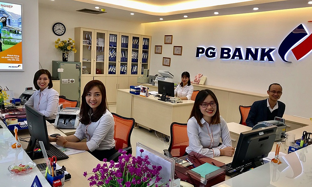 Bank tellers working in PGBank in Hanoi. Photo courtesy of PGBank.