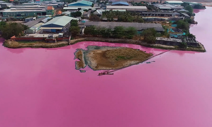 Detention basin adopts alien color, releases foul smell