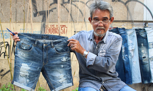 For Saigon street tailor, ripping jeans is an art