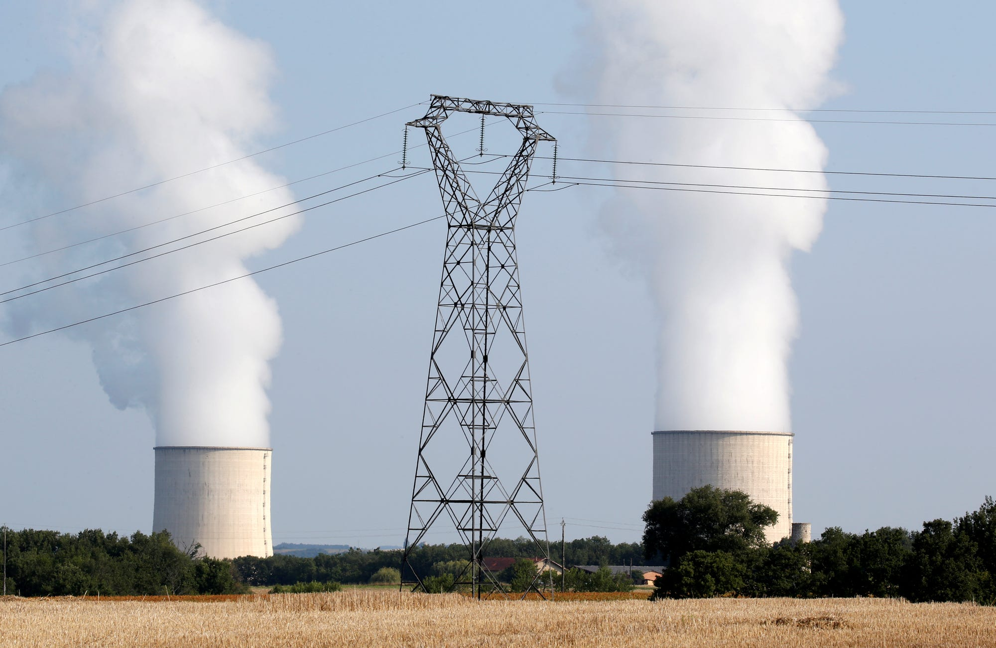 Cooling towers and high-tension electrical power lines are seen near the Golfech nuclear plant in France. Photo by Reuters.