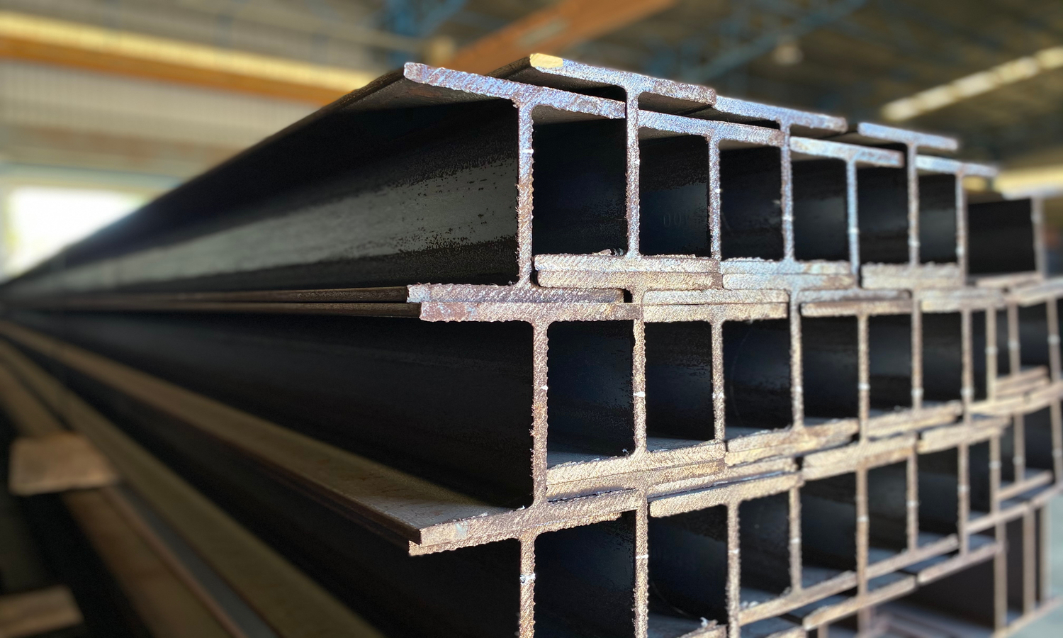 A closeup of H-shaped steel beams. Photo by Shutterstock/saweang.w.