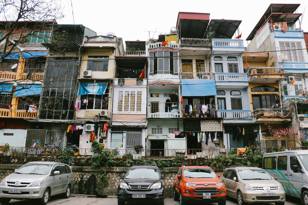 Facade of a row of tube houses in the center of Hanoi, Vietnam. Photo by Shutterstock/lulu and isabelle.
