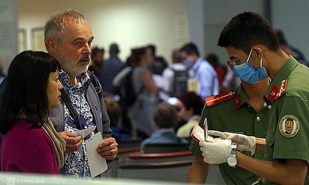 Covid-19 protocol no problem, say foreigners keenly awaiting Vietnam return