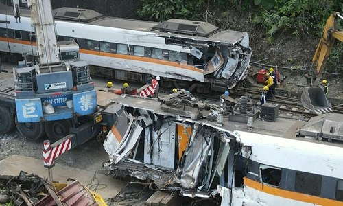 Taiwan truck driver, Vietnamese assistant charged with negligent homicide over rail crash