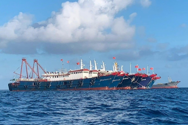 Chinese vessels, believed to be manned by Chinese maritime militia personnel, are seen at Whitsun Reef, East Sea on March 27, 2021. Photo: Handout via Reuters.