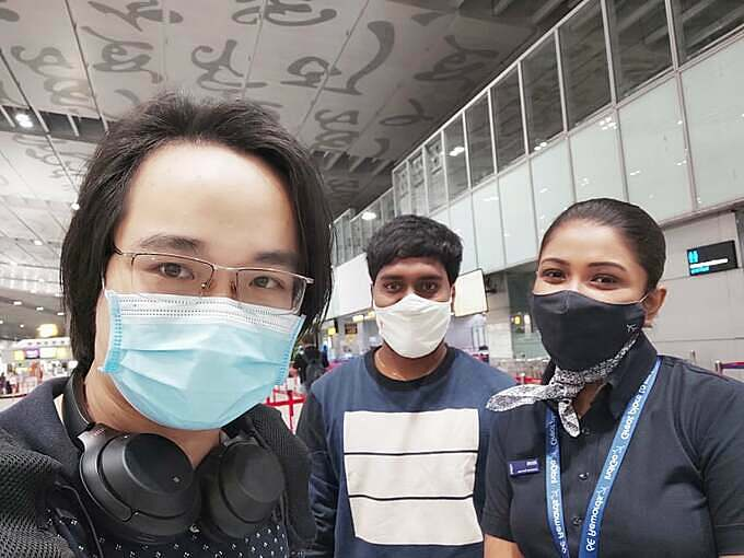 Thong Tran (L) and an Indian colleague (C) take a selfie with a flight attendant on their flight from Kolkata to Bhubaneswar, India, in early April. Photo courtesy of Thong Tran.